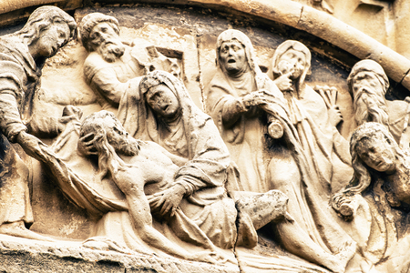 Close-up of scene of Jesus carved on stone
