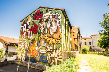 ALAVA,SPAIN - 24 AUGUST,2016: Close-up of street art painted building facade in Vitoria.