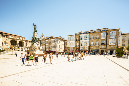 ALAVA,SPAIN - 24 AUGUST,2016: Tourists walking along Vitoria plaza in Spain.