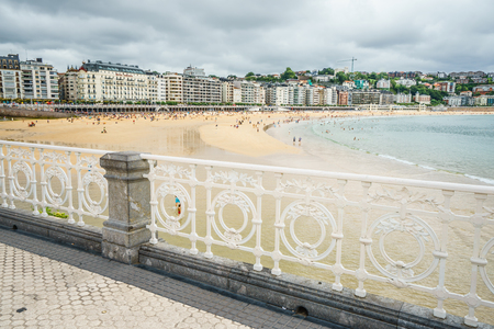 SAN SEBASTIAN,SPAIN - 30 AUGUST,2016: The famous Concha beach in overcast weather from pier