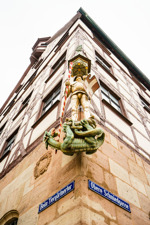 NUREMBERG,GERMANY - 5 MARCH 2016: Close-up of traditional knight decoration on edge of building. It  is a city on the river Pegnitz and the Rhine–Main–Danube Canal in the German state of Bavaria