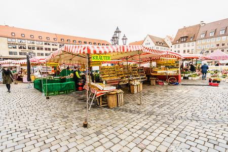 NUREMBERG, GERMANY - 5 MARCH 2016:View on tourists walking in the sidewalk in Hauptmarkt in Nuremberg Editorial