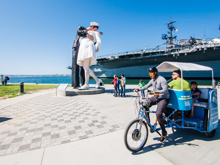 SAN DIEGO, USA - SEPTEMBER 19: Visitors on Unconditional Surrender statue on September 19, 2015 in California, United States. San Diego has estimated population of 1,381,069 as of July 1, 2014.