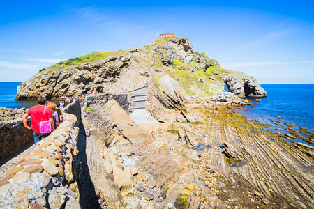 SAN JUAN DE GAZTELUGATXE, SPAIN - 12 AUGUST,2017: hermitage in the coast of Bermeo, Basque Country.HBO filmed scenes for Game of Thrones here. Stock Photo - 105370892