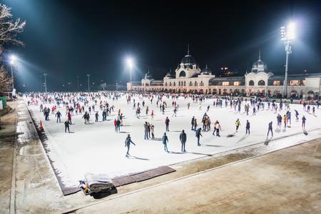 BUDAPEST, HUNGARY - DECEMBER 20, 2017: Ice skating rink beside Vajdahunyad Castle in the City Park of Budapest.