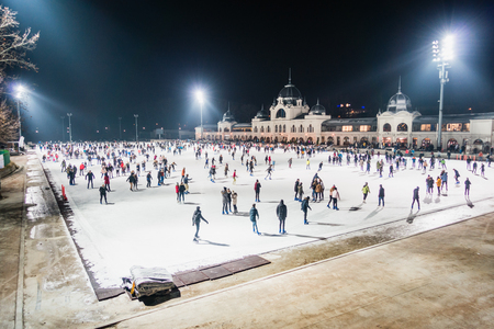 BUDAPEST, HUNGARY - DECEMBER 20, 2017: Ice skating rink beside Vajdahunyad Castle in the City Park of Budapest.