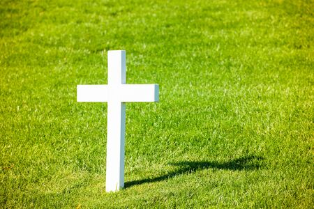 Arlington National Cemetery in Washington DC, USA - 16 October, 2016: obelus gravestone on lawn.