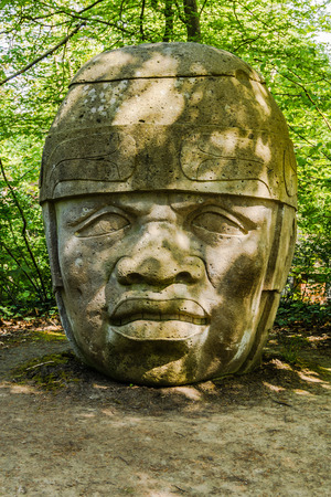 anthropology: Brussels, Belgium - May 6, 2013: Replica of Olmec Head No 8 in Tournay-Solvay Park in Brussels. The original stands in the entrance of the University of Xalapa Museum of Anthropology in Veracruz, Mexico. Editorial