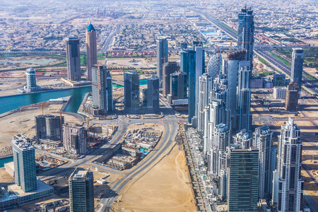 dominating: Dubai, UAE - February 3, 2015: Downtown Dubai out of observation deck of Burj Khalifa. Dominating on the right, twin towers of the JW Marriott Marquis, the tallest hotel in town. Editorial