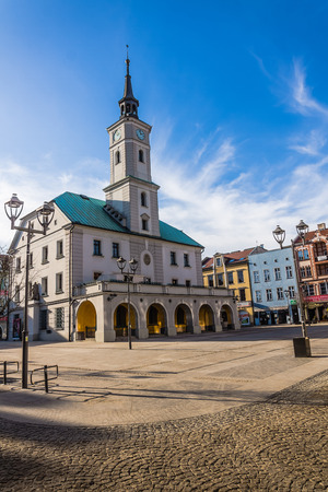 dominating: Gliwice, Poland - February 8, 2014: Historic Town Hall in the Main Market. Built in 15th century, rebuilt many times reached its final shape with dominating classicism style elements  in 20th century