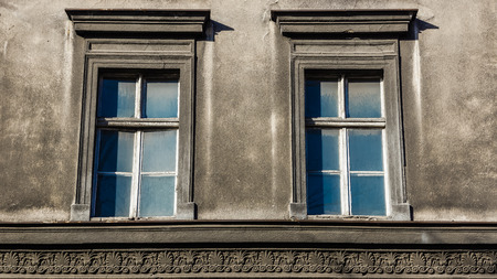 tenement: Dilapidated windows on the facade of an old tenement in Katowice, Silesia region, Poland.