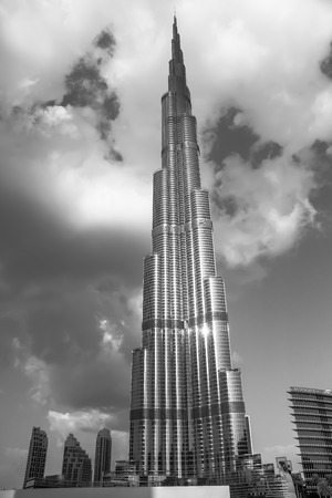 the distinguished: Dubai, UAE - February 3, 2013: Burj Khalifa, distinguished landmark of Dubai. The tallest man-made structure in the world, at 829.8 m, designed by Skidmore, Owings and Merrill firm. Editorial