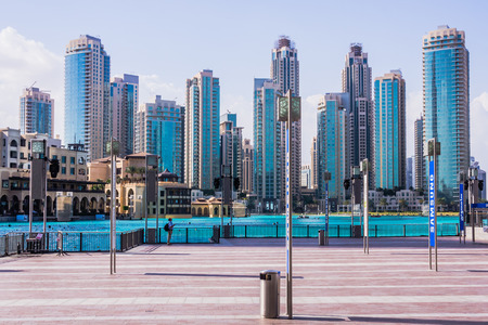 Dubai, UAE - February 3, 2013:Downtown Dubai beyond Burj Khalifa lake. In the foreground  Souk al Bahar hotel and shopping complex built in traditional Arabic architectural style. Editorial