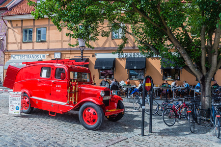 dept: Ystad, Sweden - August 12, 2014: Old fire dept. car used for city tours in Ystad. City founded in 11th century is a place of action of well-known novels by Henning Mankell with detective Wallander.