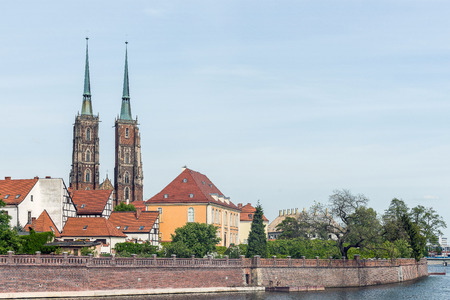 additions: Distant view on The Cathedral of St. John the Baptist, the seat of the Roman Catholic Archdiocese of Wrocław, Poland. The Gothic church with Neo-Gothic additions is located in the Ostrow Tumski the oldest part of the city. Stock Photo