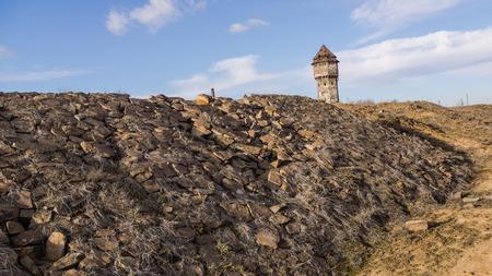 ironwork: Stone railway embankment and water tower in former, devastated Uthemann Ironwork in Katowice, Silesia region, Poland