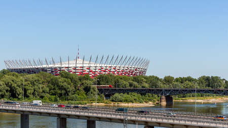 preceded: Warsaw, Poland - July 3, 2015: The Polish National Stadium preceded by the bridges over Vistula river. Designed and constructed for UEFA EURO 2012 tournament co-hosted by Poland and Ukraine.