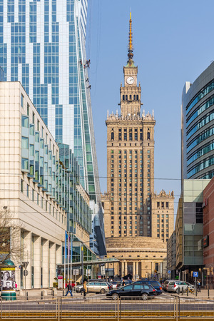 realism: Warsaw, Poland - March 25, 2015: Warsaw downtown cityscape with Palace of Culture and Science built in socialism realism style as a gift for Poland from USSR in 1955.