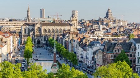 desecrated: Brussels, Belgium 05, 2013: Saint Catherines Church on the background of city skyline. Closed due to lack of faithful and desecrated, planned to be converted into a fruit and vegetables market