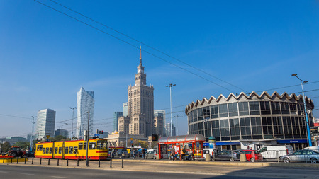 realism: Warsaw, Poland - October 9, 2013: Palace of Culture and Science built in socialism realism style, as a gift for Poland from USSR in 1955, surrounded by modern skyscrapers. Editorial