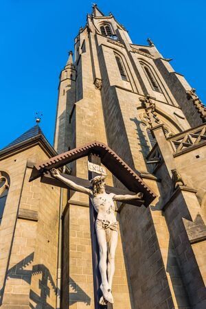 immaculate: Statue of Jesus Christ crucified in front of the Church of the Immaculate Conception of the Blessed Virgin Mary in Katowice, Silesia region, Poland. Stock Photo