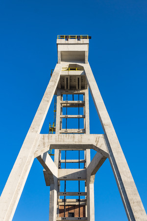 hoist: Front view of historic hoist tower of the former President mine shaft in Chorzow, Silesia region, Poland. The mine shaft was in use until 1933. Stock Photo