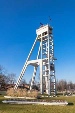 hoist: Historic hoist tower of the former President mine shaft in Chorzow, Silesia region, Poland. The mine shaft was in use until 1933.