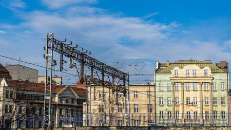 preceded: Cityscape of Katowice, Silesia region, Poland, with old tenements preceded by the railroad.