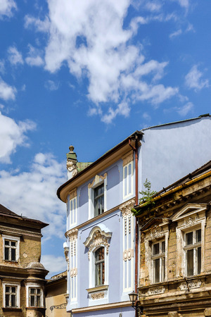 tenement: Renovated ancient tenement surrounded by dilapidated buildings in the Old Town Market Square in Bielsko-Biala, Poland. Stock Photo