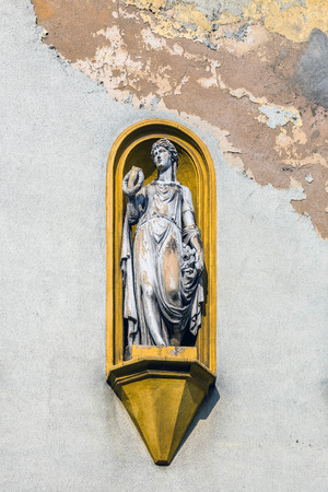 gory: Allegorical statue on the facade of the tenement in Tarnowskie Gory, Silesia region, Poland. Editorial