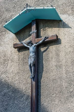 gory: Statue of Jesus Christ crucified on the wall of the St. Peter and Paul church, in Tarnowskie Gory, Silesia region, Poland.