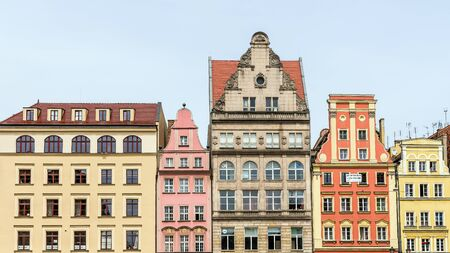 town halls: Wroclaw, Poland - May 16, 2015: Facades of ancient tenements in the 13th century Main Market Square, one of the largest markets in Europe, with the largest two town halls in Poland.
