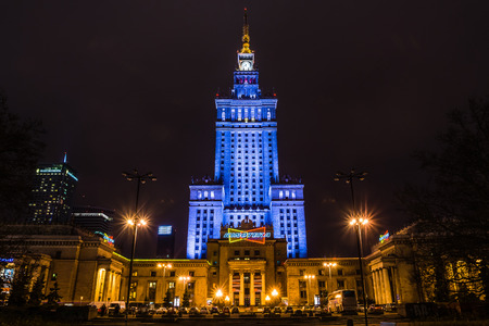 realism: Warsaw, Poland - December 29, 2013: Palace of Culture and Science built in socialism realism style as a gift for Poland from USSR in 1955 surrounded by modern skyscrapers.
