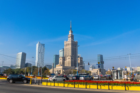socialism: Warsaw, Poland - October 9, 2013:  Palace of Culture and Science, built in socialism realism style, as a gift for Poland from USSR in 1955, surrounded by modern skyscrapers. Editorial