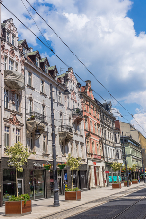 prestigious: Katowice, Poland -  July 6, 2014: Ancient tenements on 3rd May Street, the most prestigious avenue in town. Full of many shops including Galeria Katowicka, connects 2 main squares in the city. Editorial