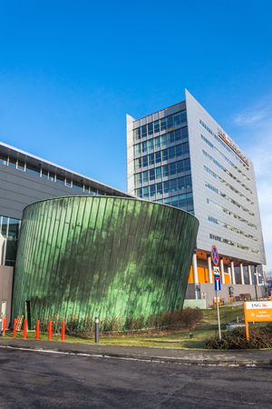 prestigious: Katowice, Poland -  February 1, 2014: Chorzowska 50 office building considered the most prestigious business complex in the city, seat of well-known companies i.a. ING, Toyota, AXA and many others.