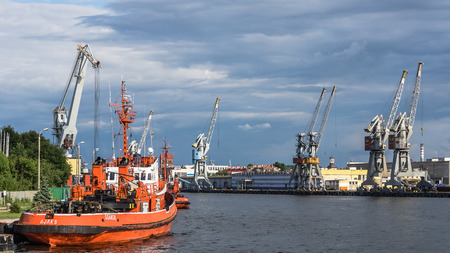 sea seaport: Gdansk, Poland - July 11, 2013: Tugboats at the quay on July 11, 2013, in the Port of Gdansk - the largest seaport in Poland, a major transportation hub in the central part of the southern Baltic Sea coast. Editorial