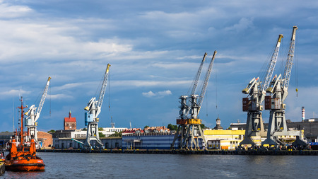 sea seaport: Gdansk, Poland - July 11, 2013: Cranes on the quay in the Port of Gdansk - the largest seaport in Poland, a major transportation hub in the central part of the southern Baltic Sea coast.
