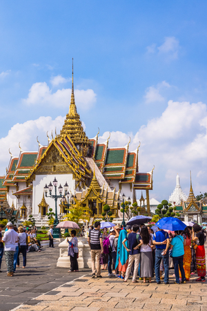 historical events: Bangkok, Thailand - October 31, 2014: Tourists in the area of The Grand Palace, historical seat of Kings of Siam, main tourist attraction of the city, still used for official events. Editorial