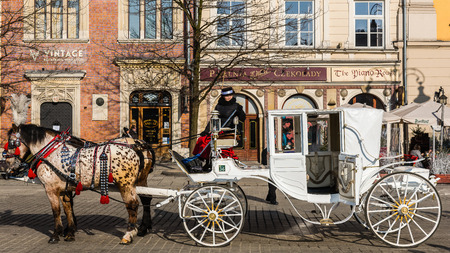 chimney corner: Krakow, Poland - February 7, 2015: Old-styled carriage in the Main Market of the Old Town. Krakow is the most popular destination in Poland, full of numerous attractions for tourists. Editorial