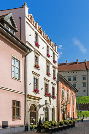 parapet wall: KRAKOW, POLAND - JUNE 03, 2015: Restaurant in an ancient tenement in the Old Town. Krakow, historical seat of Polish kings is the most popular destination in Poland, full of attractions for tourists.
