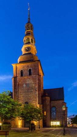 mentioned: YSTAD, SWEDEN - AUGUST 6, 2015: 13th century St.Marias Church in Romanesque style. In popular Henning Mankells novels church is mentioned as a wedding place of fictitious hero, inspector Wallander.