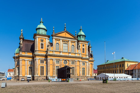 preceded: KALMAR, SWEDEN - AUGUST 7, 2015:  Kalmar Cathedral preceded by the bandstand prepared for Kalmar City Festival. The Baroque cathedral designed by Nicodemus Tessin was built in the years 1660-1703.