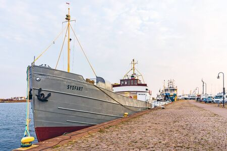 KALMAR, SWEDEN - AUGUST 8, 2015: Ships moored in the Port of Kalmar. The port owned by the municipality of Kalmar handles 1 million tons of goods per year mainly petroleum, forestry and agricultural. Editorial