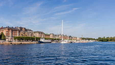 prestigious: STOCKHOLM - AUGUST 10, 2015: View on Strandvagen,  a boulevard in Ostermalm district. Completed for the Stockholm Worlds Fair in 1897, nowadays considered the most prestigious avenue in town.