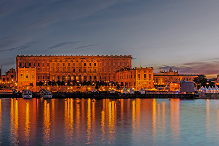decades: STOCKHOLM - AUGUST 11, 2015:The Royal Palace, residence of the Swedish monarch, erected in 1754 after decades of construction on the place of the medieval Tre Kronor Castle that burned down in 1697.