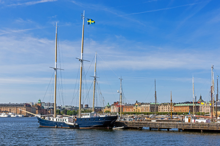 prestigious: STOCKHOLM - AUGUST 10, 2015: Sailboat moored in front of the Vasa Museum on the Djurgarden island. In the background Strandvagen, boulevard considered the most prestigious avenue in town.