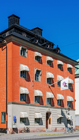 tenement: STOCKHOLM - AUGUST 10, 2015: Pauliska Huset, ancient tenement at Skeppsbron 26 in Gamla stan The Old Town, major city attraction. The house was designed by Nicodemus Tessin and built in the 1680s. Editorial