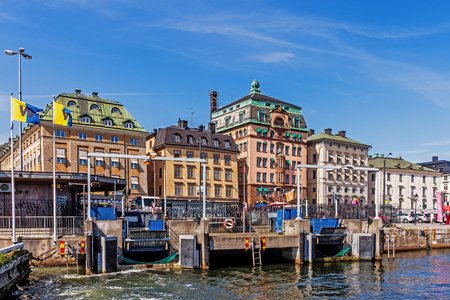 out of town: STOCKHOLM - AUGUST 10, 2015: View on Gamla stan The Old Town taken out of the departing ferry. The town dates back to the 13th century and has a rich collection of medieval architecture. Editorial
