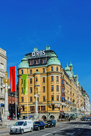 prestigious: STOCKHOLM - AUGUST 10, 2015: Strandvagen boulevard in Ostermalm district viewed out of Nybroplan square. The boulevard completed for the Worlds Fair in 1897 is the most prestigious avenue in town.